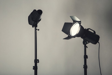 Studio lighting with tripod on black background Wall mural