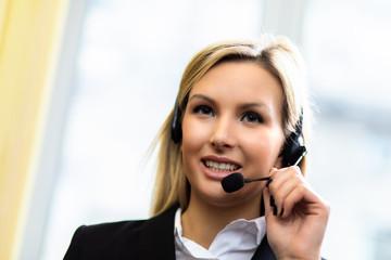 Female call center operator smiling