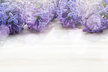 Fotorollo Flieder Beautiful floral blank for design - a border of lilac flowers on a wooden table with copy space for text