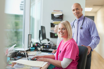 Medical professionals working in office