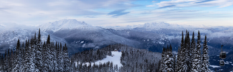 Whistler, British Columbia, Canada. Beautiful Panoramic View of the Canadian Snow Covered Mountain Landscape during a cloudy and colorful winter sunset. Wall mural