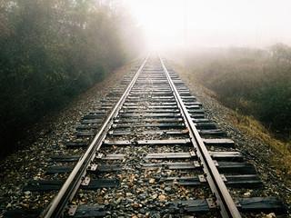 Dark Foggy Railroad Track