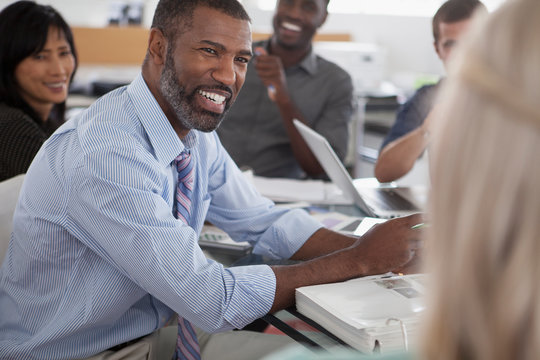 Middle aged African American man in business meeting