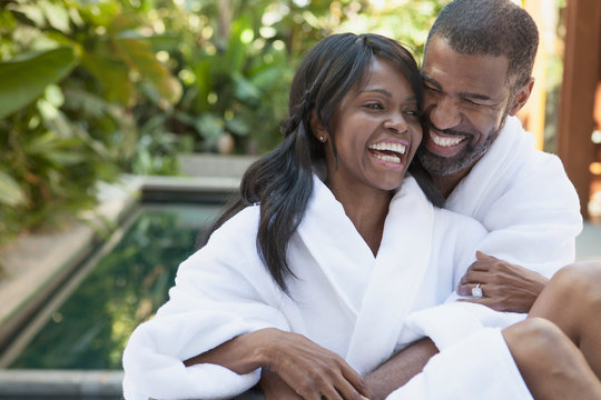 African American couple cuddling at outdoor spa