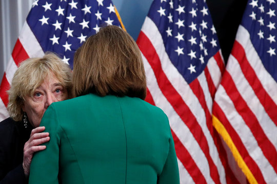 Rep. Zoe Lofgren (D-CA) whispers to House Speaker Pelosi  ahead of a news conference at the U.S. Capitol in Washington