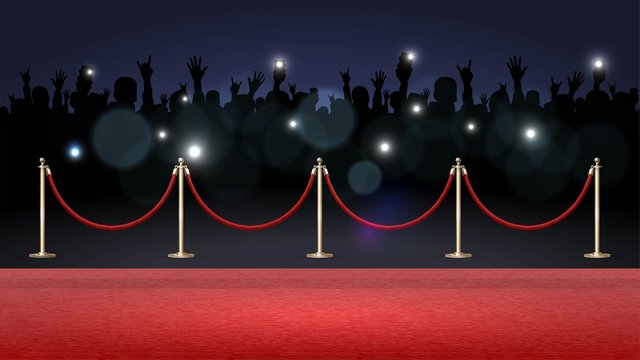 Red carpet and crowd of fans, paparazzi photographing a star on the red carpet