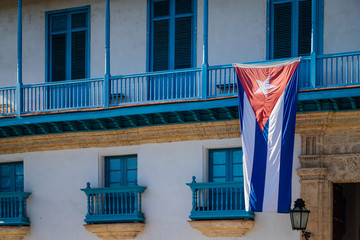 Large Cuban flag on an old building in the center of Havana