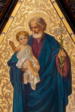 Hronsky Benadik, Slovakia. 2019/8/30. A painting of Saint Joseph holding Infant Jesus in his arms. Benedictine church.