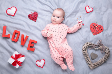 Valentine's day picture with baby girls on grey. Top view