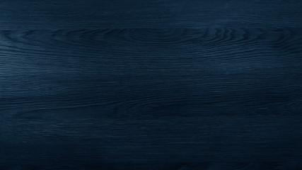 Wood texture in blue classic color. Dark wood, wooden dark background. Dark room with wooden walls.