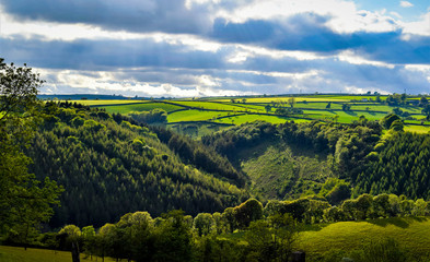Rural Cornish lanscape, Cornwall, dramatic and dynamic sunny lanscape with green hills and cloudy blue sky Fotomurales