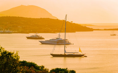 Sunrise or sunset with yachts at Porto Rotondo on Costa Smeralda at Mediterranean sea in Sardinia...