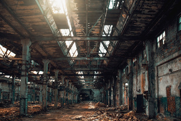 Abandoned creepy factory warehouse inside, deserted grunge industrial background.