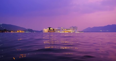Wall Mural - Udaipur Lake Palace Jag Niwas on island on lake Pichola with water ripples - Rajput architecture of Mewar dynasty rulers of Rajasthan. Sunset at Udaipur, India