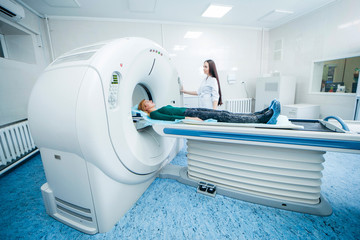 Doctor analyzes the patient on CT Scan in modern hospital