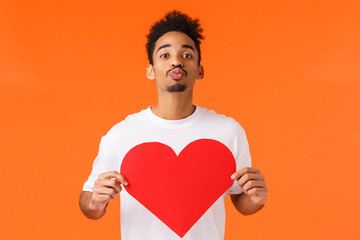 Be my valentine. Romantic cute african-american guy searching for true love, folding lips and give...