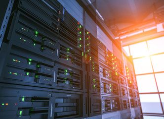 Server units in cloud service data center showing flickering light indicators for massive data connection bandwidth, close up shot.