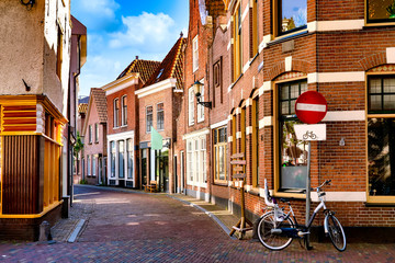 Narrow Street in the historic old town of Alkmaar, North Holland, with typical dutch houses