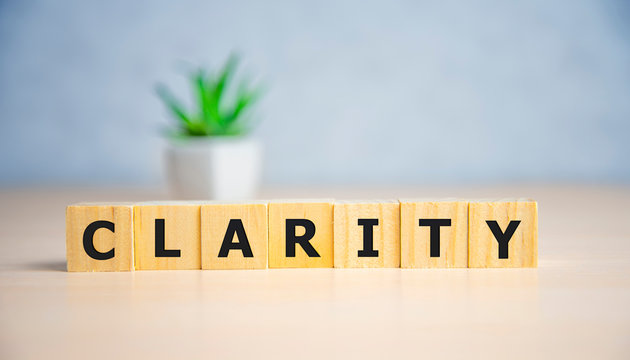 CLARITY word written on wood block, business concept.