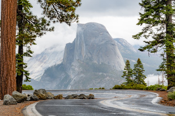 Half Dome in Yosemite National Park in October right after the rain. View from winding Glacier Point road.