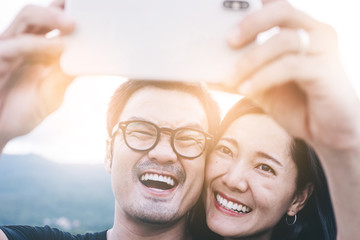 couple love concept.asian lover man and women taking a selfie while travelling on holiday hug each other.photo of people smile enjoy  Beautiful romantic time