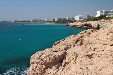 Sea, rocky coast and resort city. Agia Napa, Cyprus
