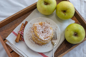 Fried pancakes filled with ripe autumn apples
