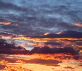 Sunrise clouds. Dramatic magical sunset over orange cloudy sky