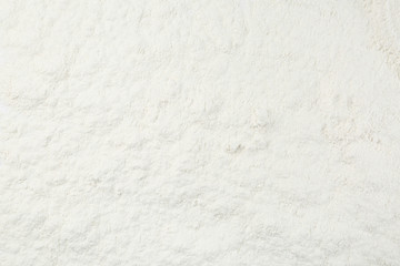 Pile of organic flour as background, top view Wall mural