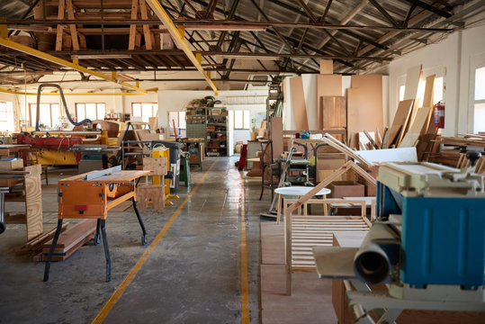 Wood and machinery in a large carpentry workshop