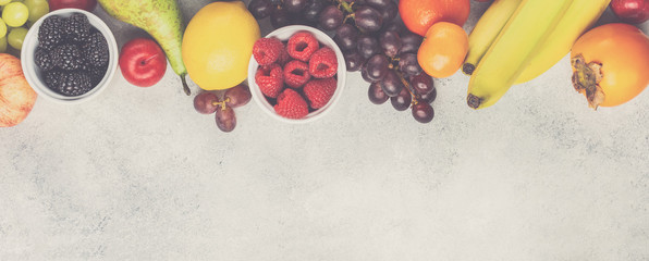 Top view of delicious fruits on white table, top view, copy space, toned, long banner, selective focus