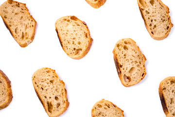 Pattern with pieces of white bread isolated on white background. Top view.