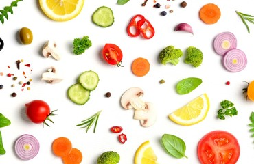 Food pattern with raw fresh ingredients of salad on white background. Creative layout made of vegetables,spices and herbs. Flat lay, top view. Food concept.