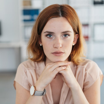 Serious young woman with a deadpan expression