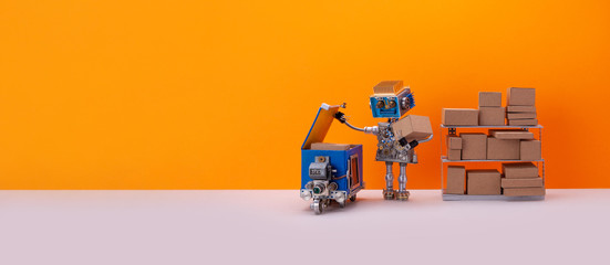 Robot storekeeper uploads parcels into an autonomous delivery robotic courier. Automation service of warehousing and shipment. Orange background, copy space