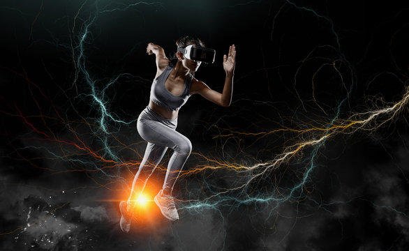 Runner woman running for Healthy. woman with VR( virtual reality ) headset glasses.Concept of Sports technology of the future