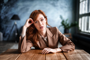 Portrait of a pretty secretary sitting at her desk