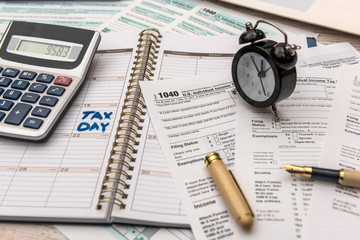 US 1040 Tax form with notepad, calculator  and pen. Tax concept