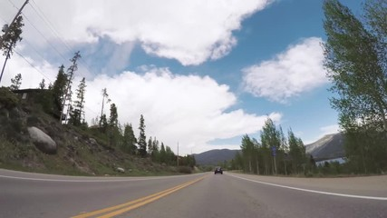 Wall Mural - Driving on mountain highway near lake Granby.