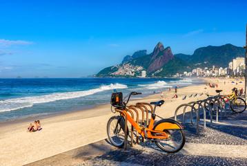 Fotomurales - Ipanema beach with mosaic of sidewalk in Rio de Janeiro. Brazil