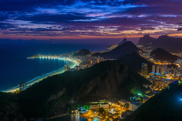 Fototapete - Sunset view of Copacabana,  Urca and Botafogo in Rio de Janeiro, Brazil. Skyline of Rio de Janeiro. Night cityscape of Rio de Janeiro