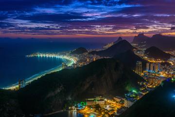 Fotobehang - Sunset view of Copacabana,  Urca and Botafogo in Rio de Janeiro, Brazil. Skyline of Rio de Janeiro. Night cityscape of Rio de Janeiro