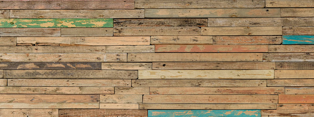 Wooden Background From Many Old Painted Boards In Different Colors. Panoramic Wide Multicolored Rough Texture. Woodern Banner.
