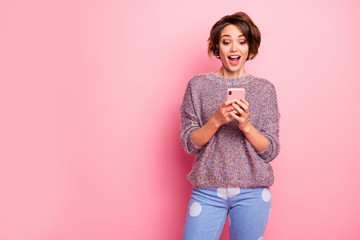 Portrait of her she nice attractive lovely pretty winsome charming cute cheerful cheery glad brown-haired girl using cell fast speed connection isolated over pink pastel color background