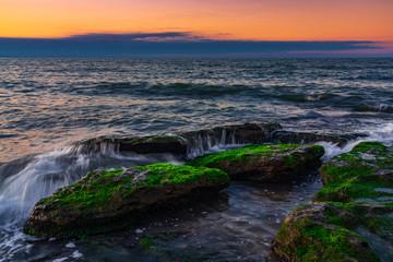 Waves crashing on the rocky seashore