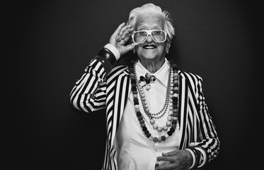 Funny grandmother portraits. Senior old woman dressing elegant for a special event. granny fashion...