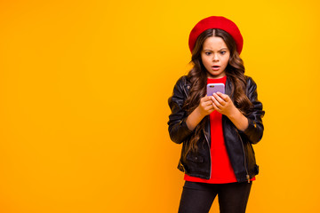 Portrait of her she nice attractive pretty lovely worried long-haired girl wearing streetstyle using cell browsing fake news isolated over bright vivid shine vibrant yellow color background