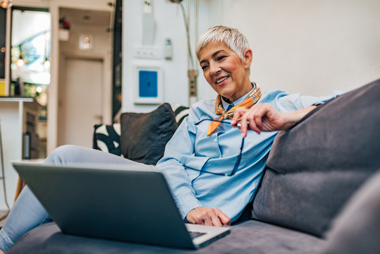 Portrait of mature woman using laptop at home.