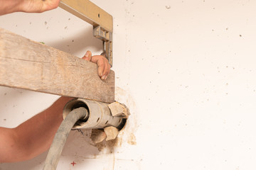 Wall breakthrough through a core drilling by professionals with the aid of a machine