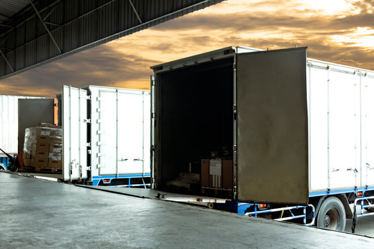 Freight industry transport, warehouse and logistics, truck container docking load cargo shipment goods at warehouse.